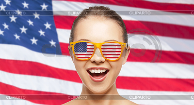 5202862-happy-teenage-girl-in-shades-with-american-flag.jpg