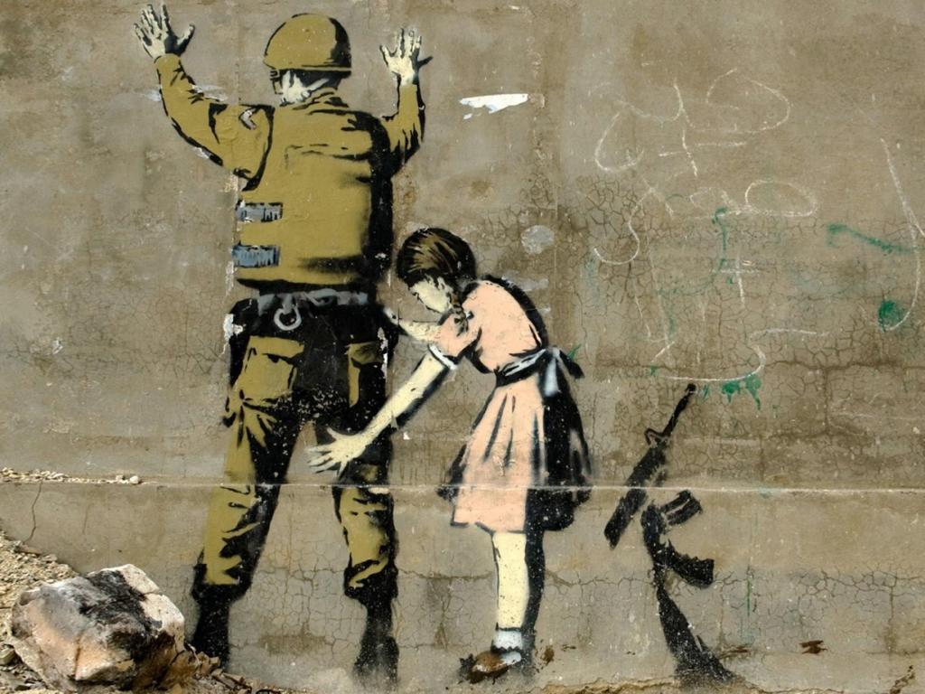 Girl-searching-a-soldier-graffiti-banksy-1600x1200.jpg