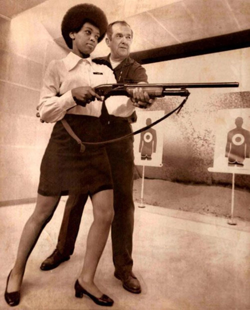Saundra-Brown-the-first-black-woman-on-the-Oakland-police-force-gets-instructions-on-how-to-shoot-a-shotgun-1970.jpg